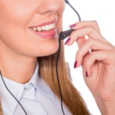 Beautiful young call-center assistant smiling, woman customer service worker, call center smiling operator with phone headset isolated on white background